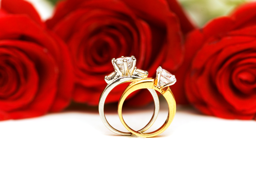 Diamond rings and roses isolated on the white