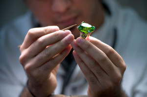 A jeweler works on a piece of the French